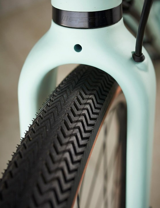 The distinctive sawtooth tread and neatly routed hydraulic line