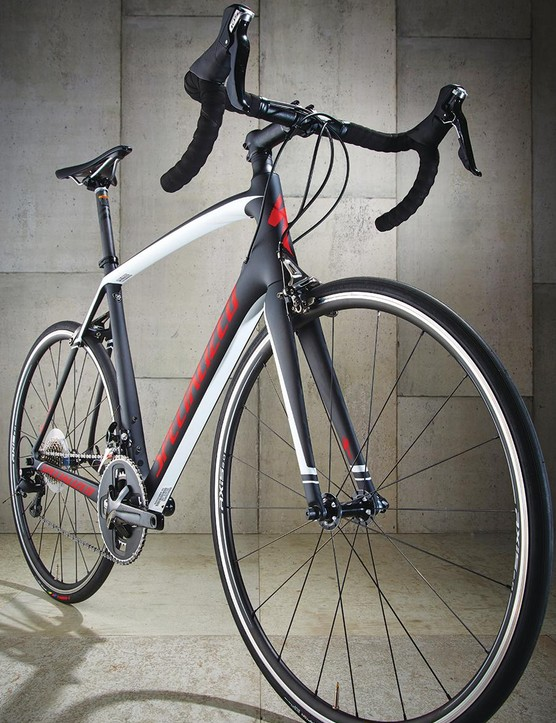 The signature arched top tube is present and correct