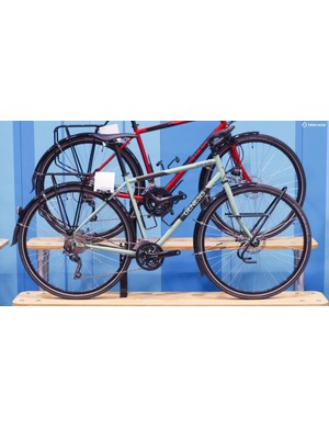 In full touring guise with flat bars, racks, lights, and Deore components, the TdF costs £1,499.99