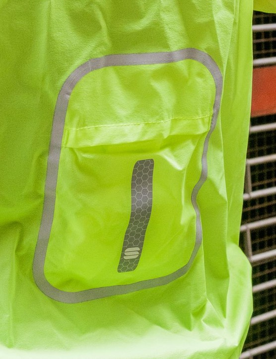 The jacket packs down into the small pocket, which doubles up for storage when worn