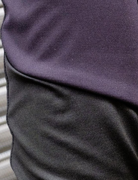 A NoRain fabric features across the front and upper sleeves of the top, with a lighter fabric on the lower arm and back