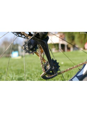 The new derailleur has a longer cage to cope with the extra gear. The upper jockey wheel is also offset more