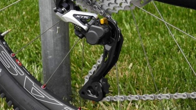 Clutch type rear derailleurs, like this XTR Shadow Plus, help keep the chain from coming off the bottom of the chain ring