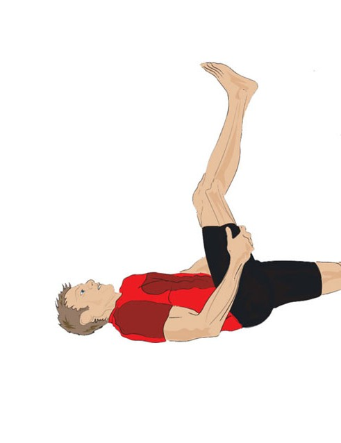 Lying on your back, keep one leg straight and on the floor. Take hold of the other leg behind the knee and, keeping it as straight as feels comfortable, draw the knee towards your face. It can help to use a towel around your foot