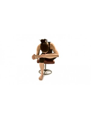 Seated glute stretch and hip opener