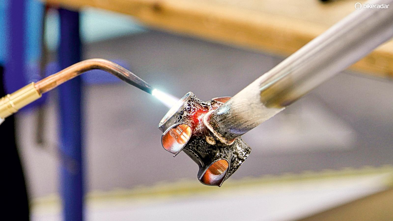 The students learn many skills including welding
