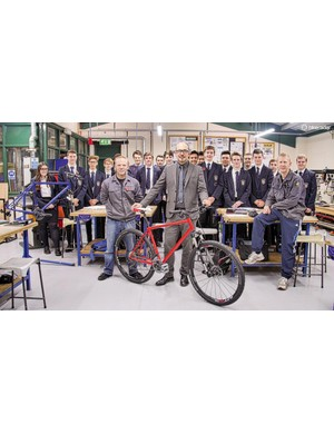 Andrew Jones (centre) with the D&T teachers and pupils, and one of the first mountain bikes in class