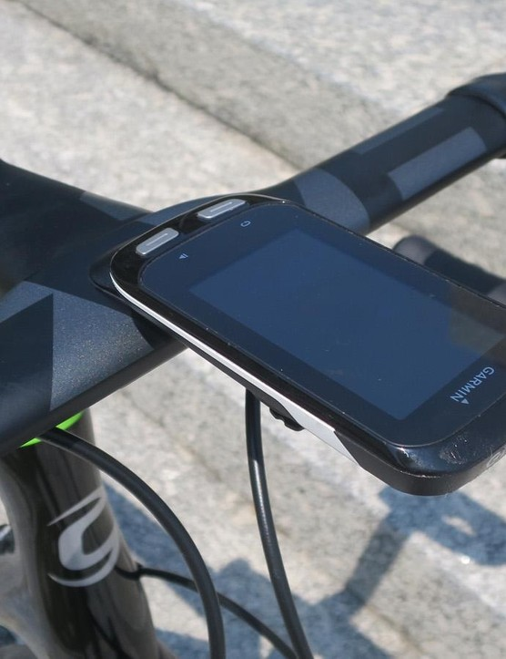 The integrated out front mount takes a Garmin on top and a Fabric Lumaray light below