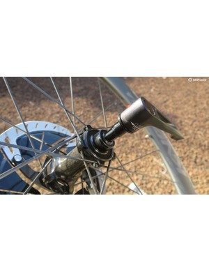 The speed release thru-axle stays attached to the wheel when you release it
