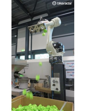 This robot takes mouldings from bottle lids and bite valves, assembles them and then drops them into a hopper to be matched up with bottles
