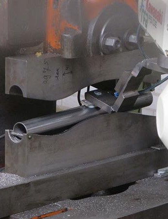 The tubing being bent and formed before welding