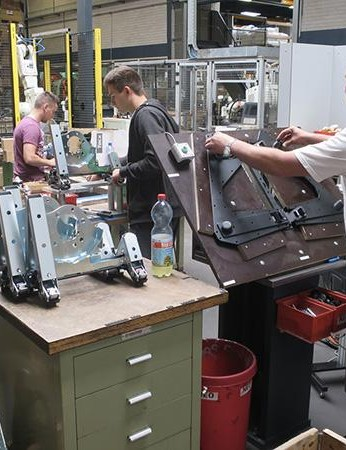 The Neo's assembly line combines hand assembly and robot controlled elements