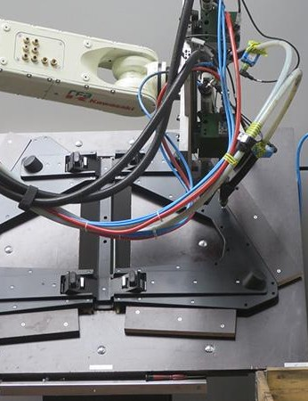 This robot controlled bolting and binding ensures perfect torque settings on the Neo's construction