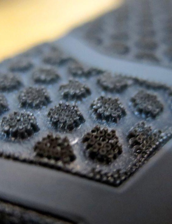 The volcano-shaped micro-pillars from the original CPC saddle are now arranged in this honeycomb pattern