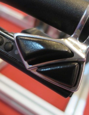 Two buttons on the under bar-mounted shifter