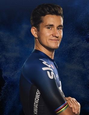 Michal Kwiatkowski's jersey has the rainbow bands of a former world champion
