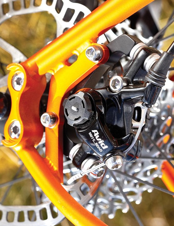 Steel-bodied Avid BB7 disc brakes keep the material theme consistent