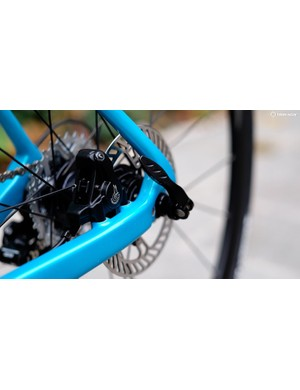 The bike is tied together at either end with thru-axles