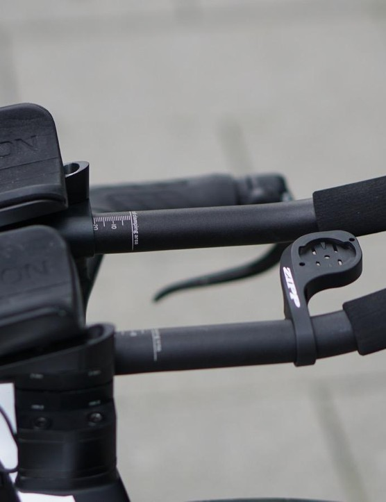 While the rest of the peloton uses tape, Martine has Ergon grips for the cowhorns and the extensions