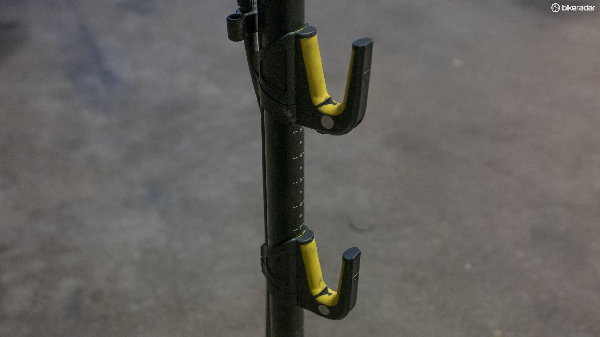 The rear triangle of your bike hangs in adjustable rubber-coated hooks