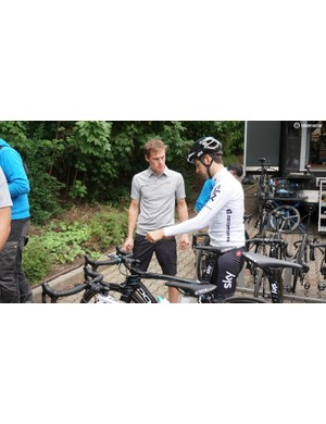 Team Sky's Mikel Nieve talks with mechanic Ryan Bonser about his handlebar set-up