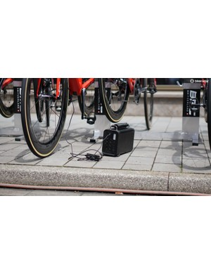 Here's something you didn't see at the Tour de France 10 years ago: a portable battery for charging a fleet of Shimano Di2 batteries