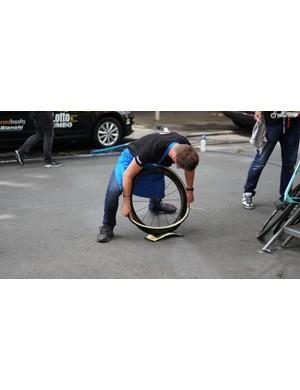 Team Lotto'Jumbo mechanics use a Tacx trainer wheel block to protect wheels while mounting fresh tubulars
