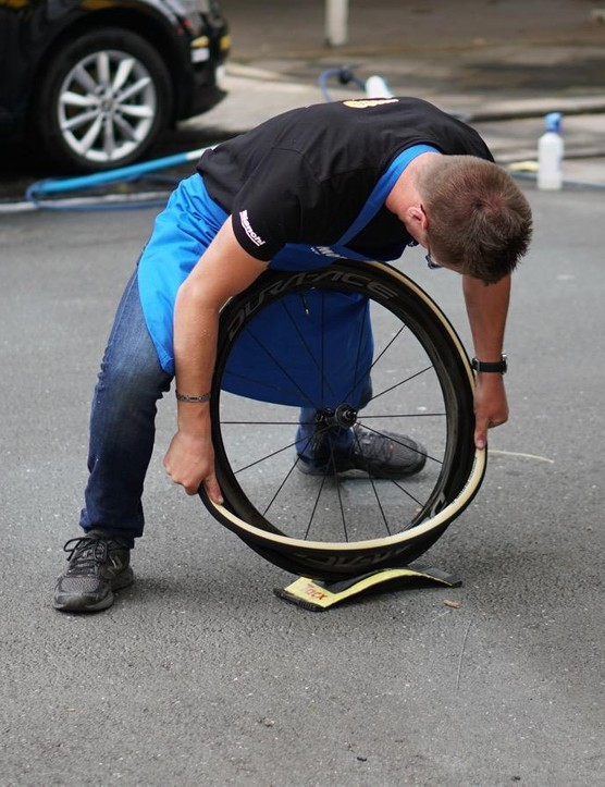 Team Lotto'Jumbo mechanics use a Tacx trainer wheel block to protect wheels while mounting fresh tubulars