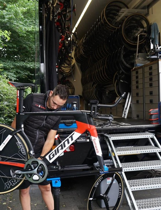 As this year's Tour starts with a time trial, mechanics worked to prep road and TT bikes