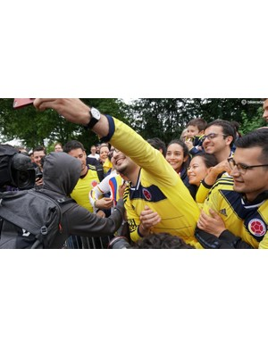 Fans' clothing isn't always team-specific; it's often nation-specific. Here, Colombian fans go crazy for Orcia-Scott's leader Esteban Chaves