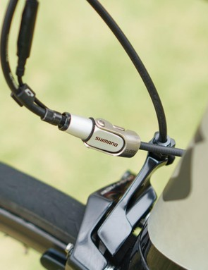 An inline adjust is fitted to the rear brake cable to make on-bike adjustments possible
