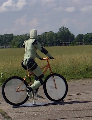 In the US, Toyota's  crash test dummy cyclists use a small electric motor to make the pedals move realistically