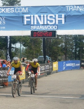 United Cycles cross the line, with La Ruta right behind