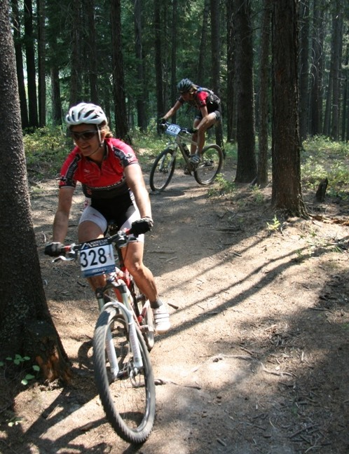 Women's leader Sue Haywood leads teammate Hillary Harrison through the singletrack