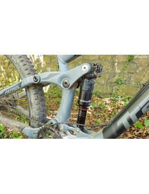 There's a trunnion-mounted RockShox Deluxe RT shock at the back