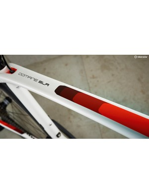 The top tube flares towards the seat-tube before parting like the Red Sea