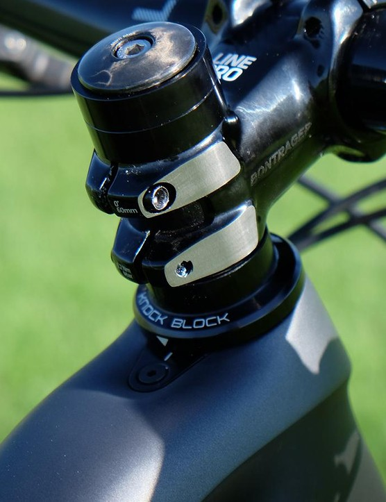 Trek's 'Knock Block' headset keeps the fork from impacting the down tube (as well as stopping the handlebar or brake levers from marring the top tube in the event of a crash)