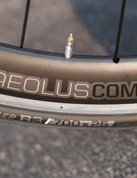 The Aeolus Comp 5 wheels are fast at speed — the wind doesn't care whether your wheels are all-carbon or this fairing-style alloy. And that alloy brake track is better for stopping. But the wheels are on the heavy side, and the rims take on water in the rain or when washing the bike