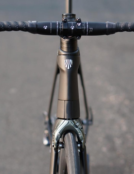 The Madone 9.0 has the same frame and fork as the top-end 9.9, but with a relatively normal handlebar