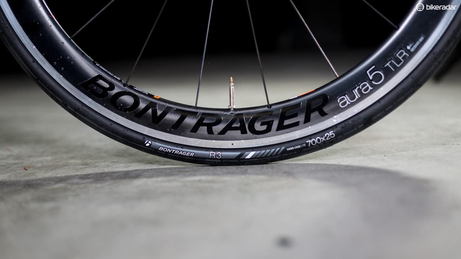 Bontrager's Aura 5 TLR wheel is an alloy rim with a flexible carbon fairing