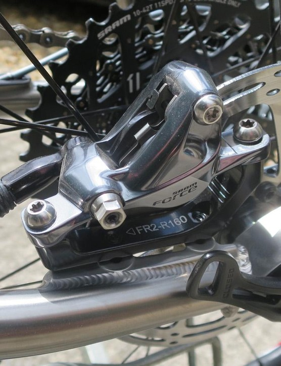 The frame now uses the flat mount brake standard, though my build kit is with SRAM Force 1 standard mount brakes