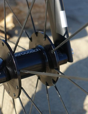 AeroCoach's AEOX front wheel uses a striking narrowed, high-flange front hub with a heavily profiled set of axle end caps