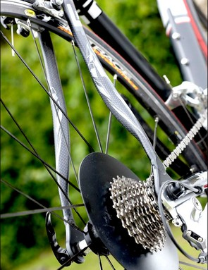 carbon wishbone seatstays in place of a pair of welded aluminium tubes here speeds up large production runs and saves a few grams