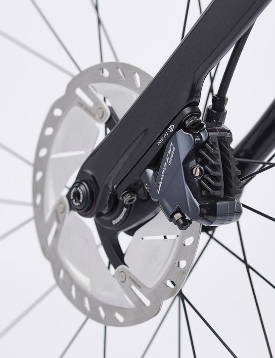 Disc brakes offer better braking performance and extra clearance for wider tyres