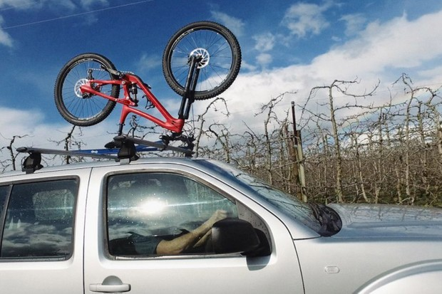The Upside Rack attaches to your handlebars and seat rather than wheels and fork
