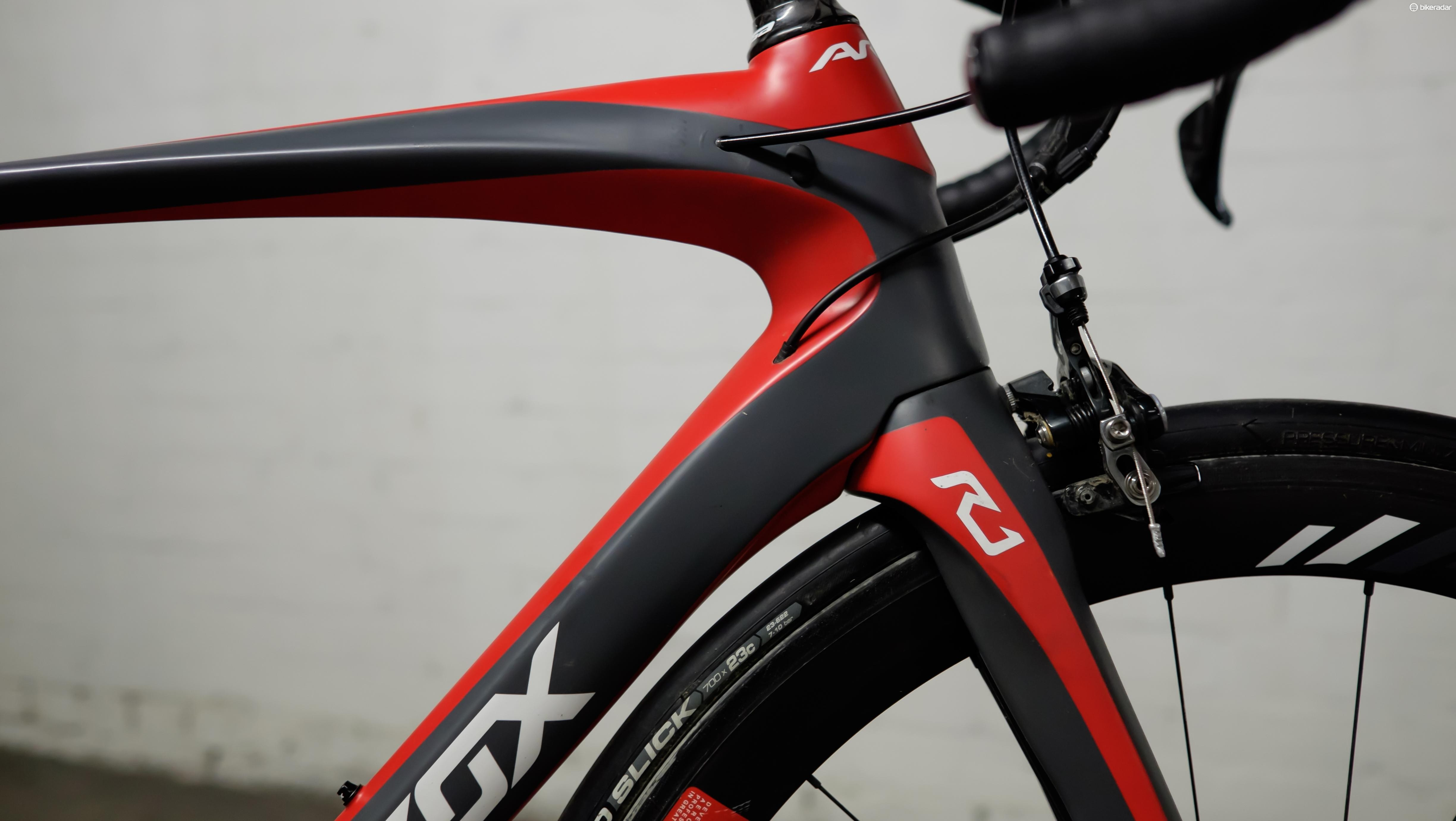The 'shoulder blade' of the fork integrates neatly into a sculpted section of the frame's downtube