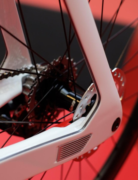 The fins at the chainstay act to cool the rear brake caliper, which itself is tucked away inside the frame