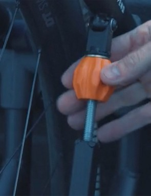 Tension on the wheel can be adjusted with a barel adjuster