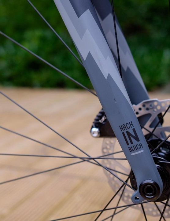The thru-axle carbon fork also uses a tapered steerer