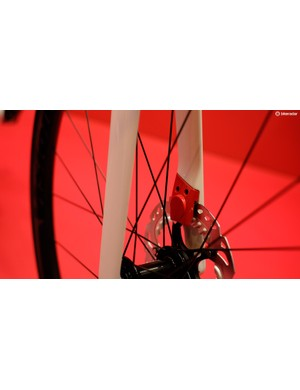 The front brake caliper gets its own aerodynamic cover